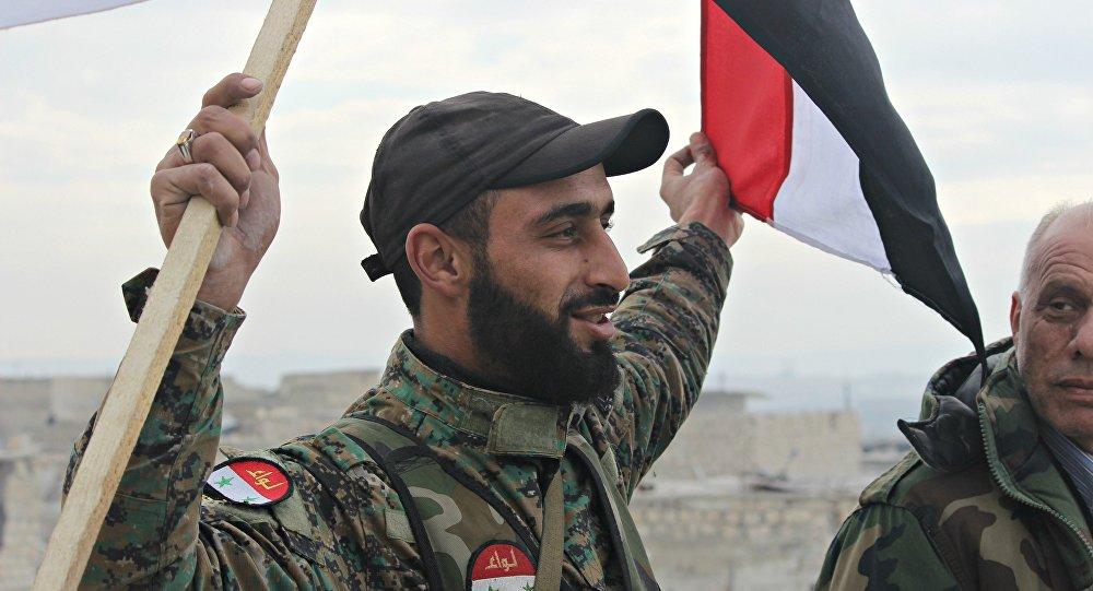 Des soldats syriens célébrant la victoire