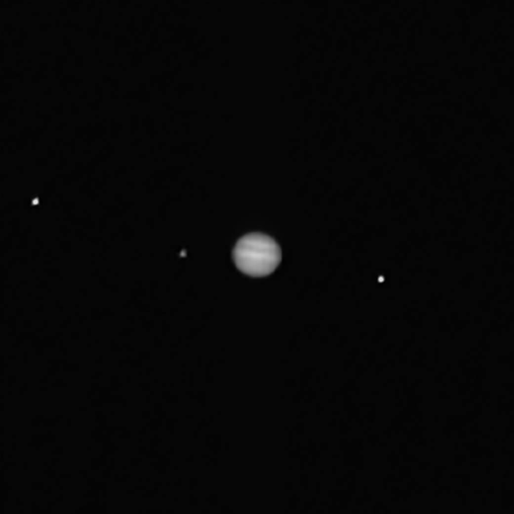 Jupiter et ses trois satellites