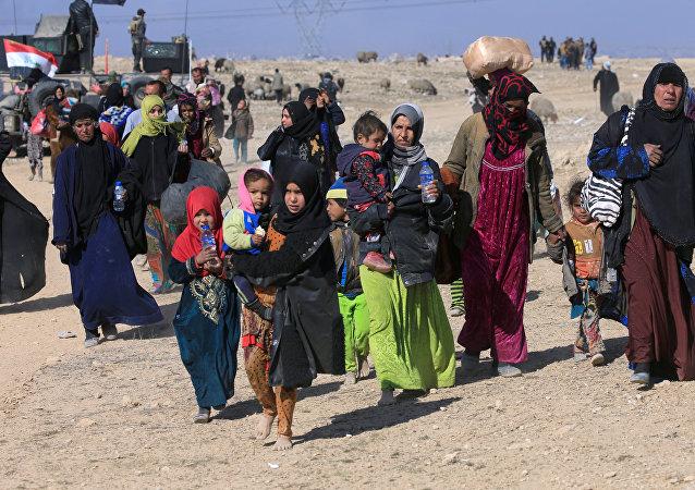 Des réfugiés de la ville de Mossoul