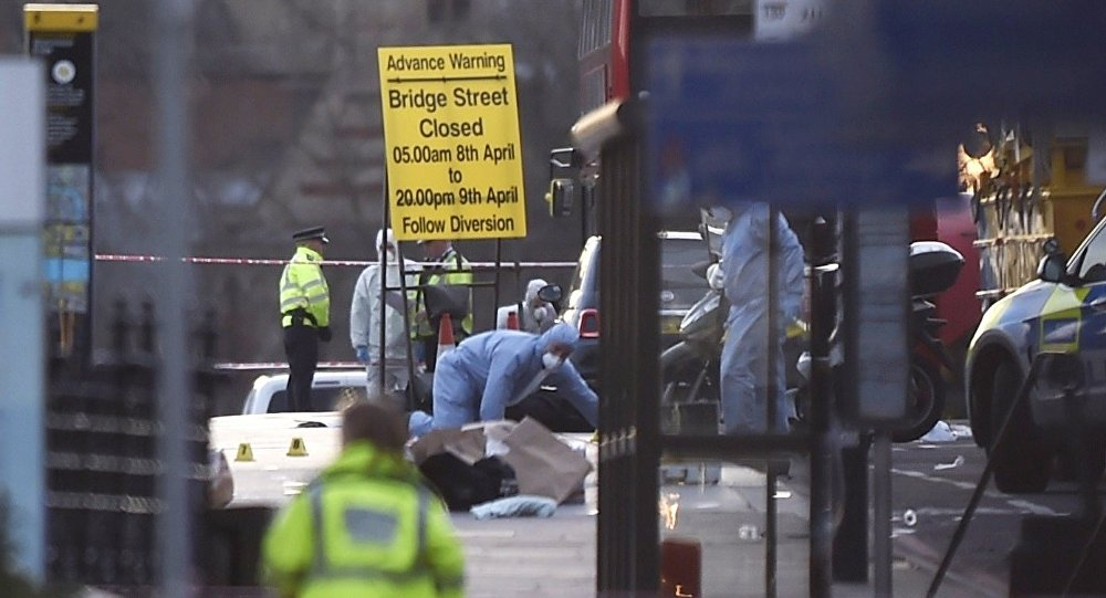 Forensics investigators work at the scene after an attack on Westminster Bridge in London, Britain March 22, 2017.