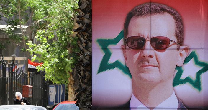 Poster montrant un portrait du Président Bachar al-Assad