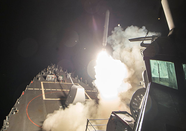 U.S. Navy guided-missile destroyer USS Ross (DDG 71) fires a tomahawk land attack missile in Mediterranean Sea which U.S. Defense Department said was a part of cruise missile strike against Syria on April 7, 2017.