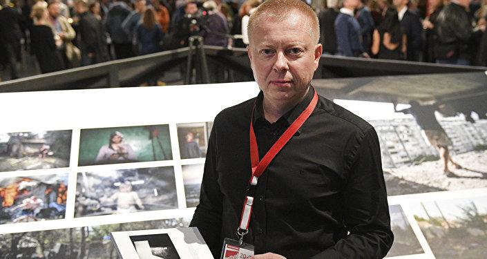 Специальный фотокорреспондент МИА Россия сегодня Валерий Мельников, победивший в конкурсе World Press Photo 2017 в номинации Долгосрочные проекты, на открытии выставки победителей World Press Photo в Амстердаме.