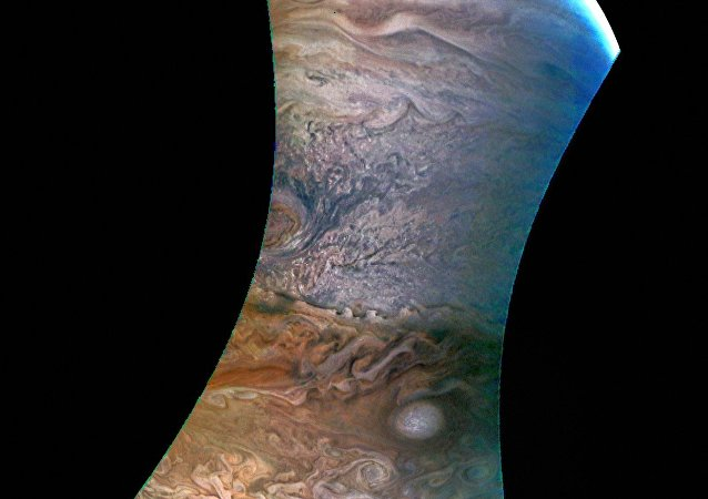 An image of Jupiter taken by Juno and colored by an amateur astronomer.