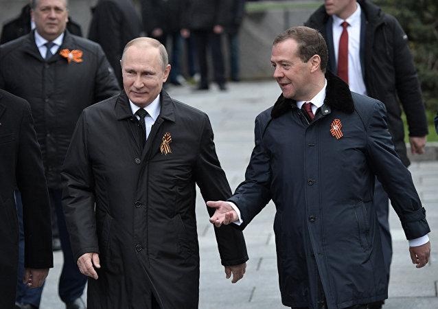 Russian President Vladimir Putin and Prime Minister Dmitry Medvedev