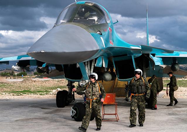 Des pilotes russes à la base aérienne de Hmeimim  m en Syrie
