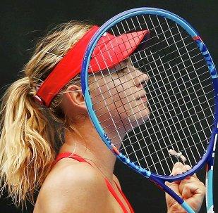 Maria Sharapova of Russia celebrates defeating Alexandra Panova in Melbourne January 21, 2015