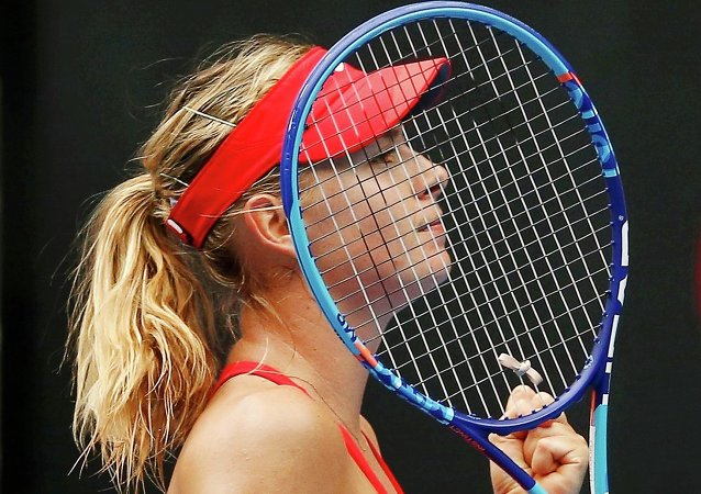 Maria Sharapova of Russia celebrates defeating Alexandra Panova in Melbourne January 21, 2015