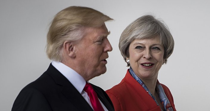 US President Donald Trump and British Prime Minister Theresa May walk at the White House on January 27, 2017 in Washington, DC.