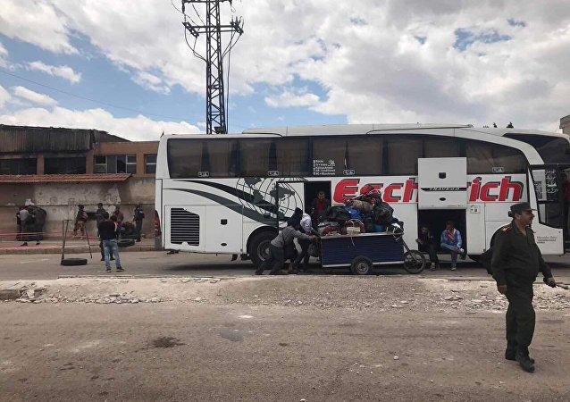 La dernière étape du retrait des terroristes du quartier d'Al Waer à Homs