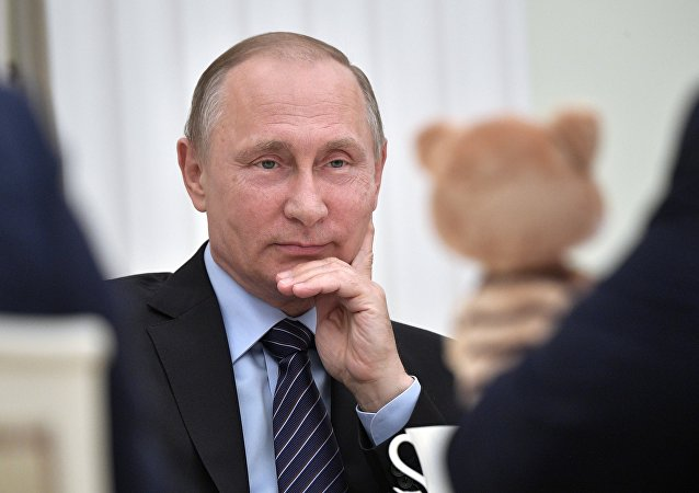 Vladimir Poutine, Président russe et… parrain aimant