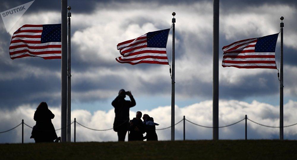 Tourists at the Washington Monument in Washington, D.C.