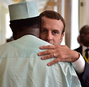French President Emmanuel Macron (C) hugs Chad president Idriss Deby (L) during a G5 Sahel summit, in Bamako, on July 2, 2017, to boost Western backing for a regional anti-jihadist force for the Sahel region amid mounting insecurity and cross-border trafficking.