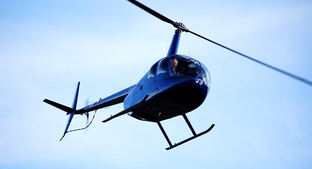 Robinson R44 hélicoptère (image d'illustration)