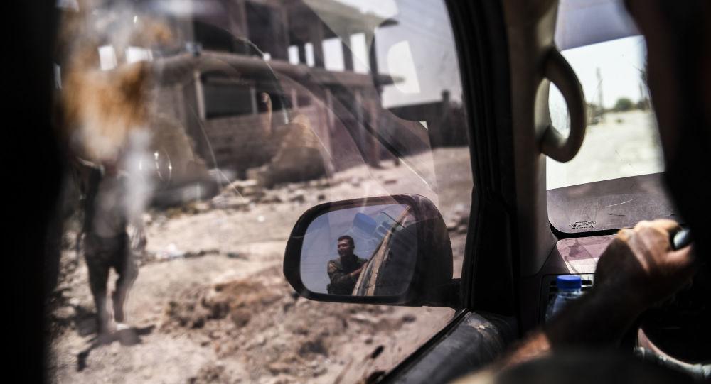 Des militaires SDF à Raqqa
