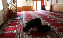 A man prays at a mosque where imam Abdelbaki Es Satty preached in Ripoll, north of Barcelona