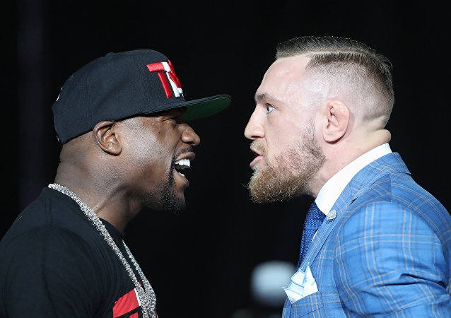 Floyd Mayweather and Conor McGregor stare each other down during a world tour press conference to promote the upcoming Mayweather vs McGregor boxing fight at Budweiser Stage.