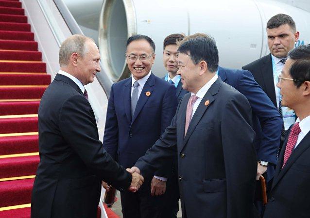 Poutine arrive en Chine pour le sommet des BRICS
