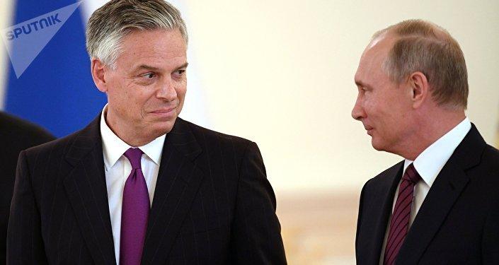 Jon Huntsman et Vladimir Poutine