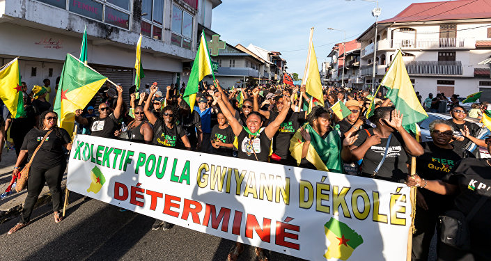 Demonstrators march in Cayenne, French Guiana, on October 26, 2017, during an official visit by French President Emmanuel Macron.