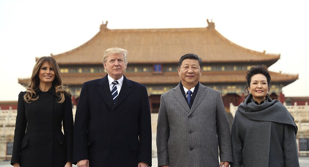AP Photo/President Donald Trump, second left, first lady Melania Trump, left, Chinese President Xi Jinping, second right, and his wife Peng Liyuan, right, stand together as they tour the Forbidden City, Wednesday, Nov. 8, 2017, in Beijing, China. Trump is on a five country trip through Asia traveling to Japan, South Korea, China, Vietnam and the Philippines.