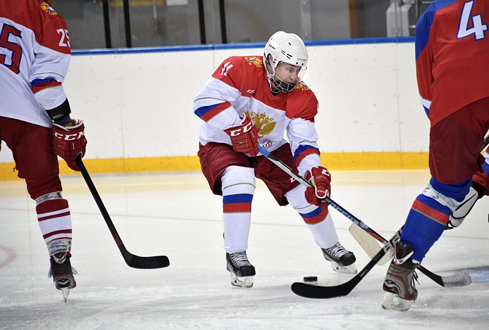 Vladimir Putin plays hockey