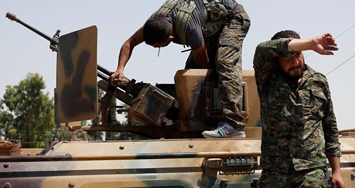 Des combattants des Unités de protection du peuple kurde (YPG)