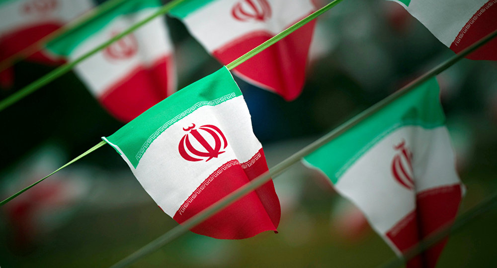Iran's national flags are seen on a square in Tehran, Iran February 10, 2012