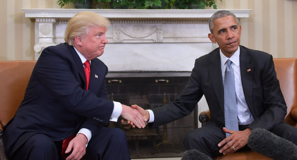 US President Barack Obama and President-elect Donald Trump shake hands during a transition planning meeting in the Oval Office at the White House on November 10, 2016