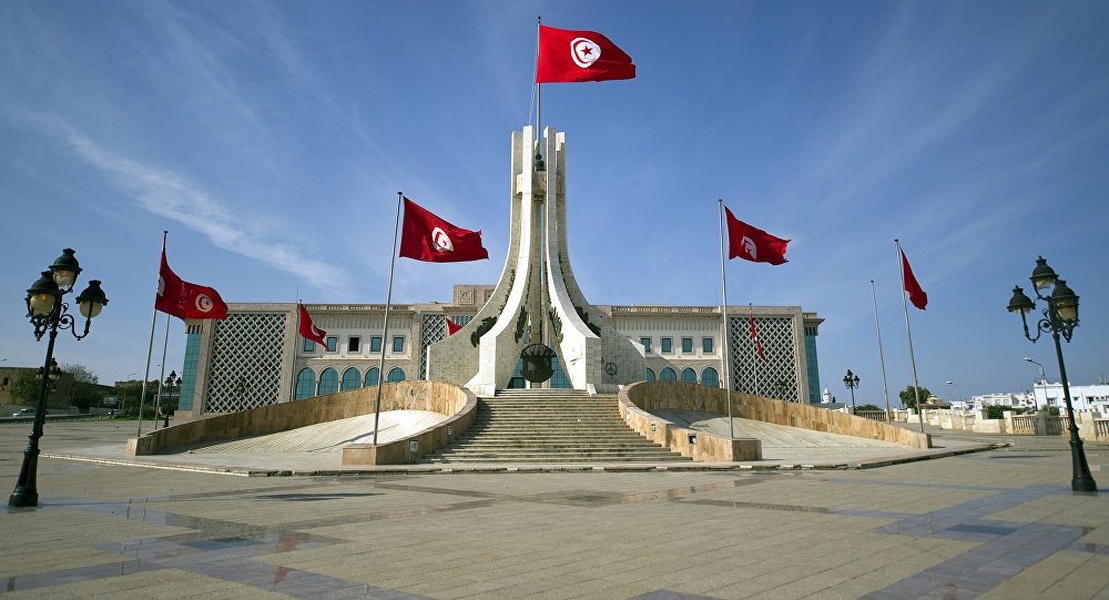 Flags of Tunisia flutter at the city hall in Tunis on October 24, 2011