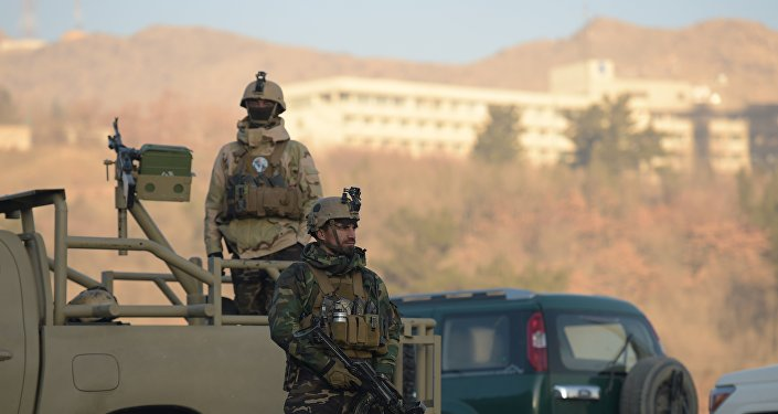 Afghan security forces keep watch near the Intercontinental Hotel following an attack in Kabul on January 21, 2018.