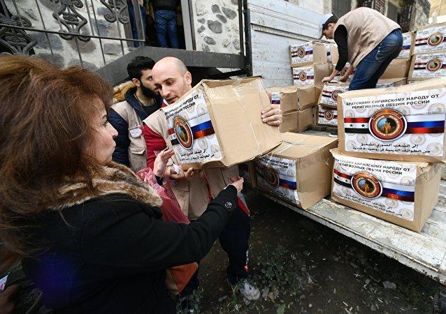 Distribution d'aide humanitaire envoyée par les croyants russes à Damas