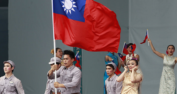 Des danseurs se produisent lors de la cérémonie d'inauguration du président de Taiwan Tsai Ing-wen à Taipei, Taiwan, vendredi 20 mai 2016