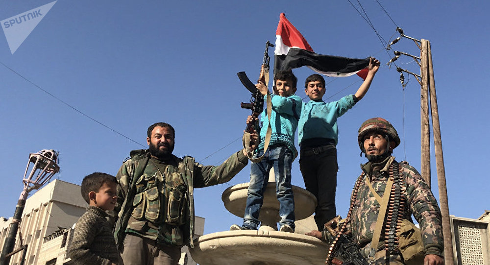 Locals in the liberated town of Kafr Batna in Eastern Ghouta