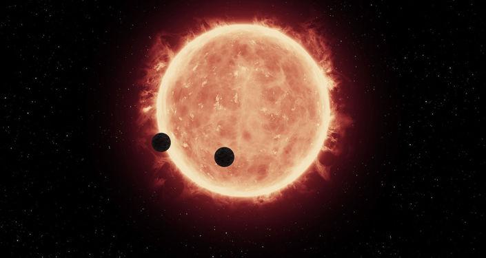 Vue d'artiste des planètes TRAPPIST-1b et TRAPPIST-1c sur fond d'une naine rouge