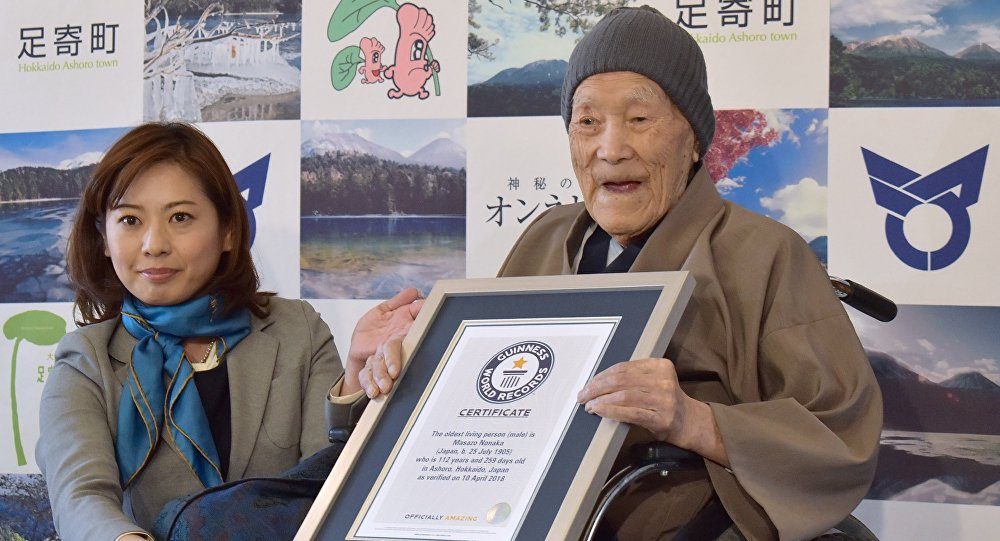 Masazo Nonaka of Japan (R), aged 112, receives a certificate for the Guinness World Records' oldest male person living title from Erika Ogawa (L), vice president of Guinness World Records Japan, in Ashoro, Hokkaido prefecture on April 10, 2018. Nonaka was born on July 25, 1905.