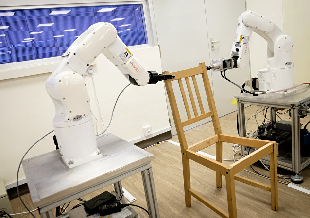 Robots assemble an Ikea chair at Nanyang Technological University (NTU) in Singapore April 17, 2018