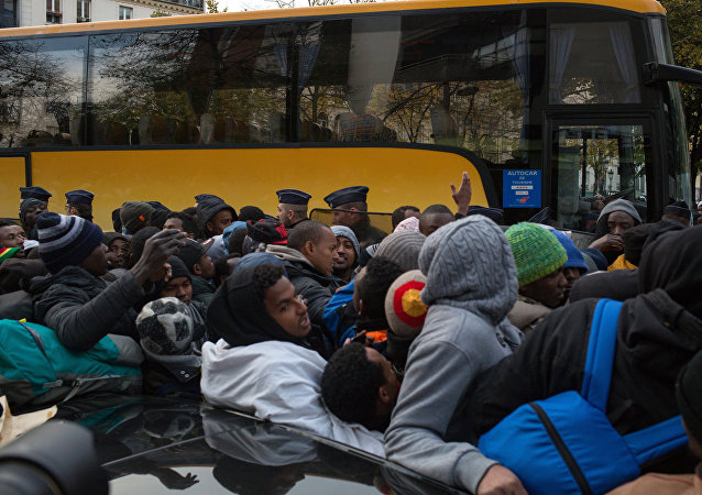 Migrants à Paris. Photo d'archive