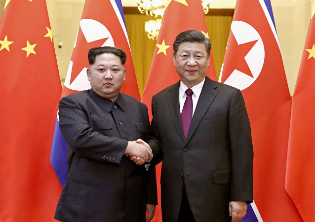 Kim Jong Un et Xi Jingping