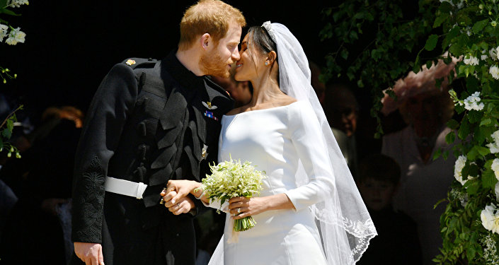 Prince Harry and Meghan Markle kiss on the steps of St George's Chapel in Windsor Castle after their wedding in Windsor, Britain, May 19, 2018