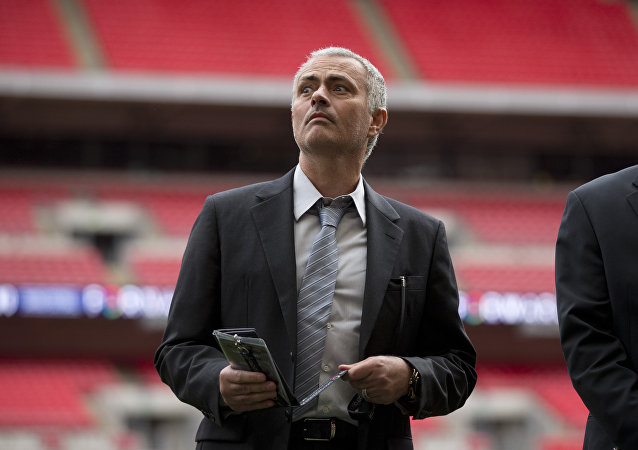 Former Chelsea manager Jose Mourinho attends a group photo session pitchside as a guest of FIFA Presidential Candidate Gianni Infantino after unveiling his 90 day plan that he will implement if he is elected FIFA President, at Wembley Stadium in London, Monday, Feb. 1, 2016.