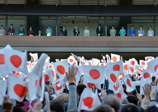 Japanese Emperor Akihito (C) and Empress Michiko (7th R) greet well-wishers with other members of the royal family from the balcony of the Imperial Palace in Tokyo on January 2, 2016