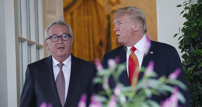 President Donald Trump, right, and European Commission president Jean-Claude Juncker arrive to speak in the Rose Garden of the White House, Wednesday, July 25, 2018, in Washington