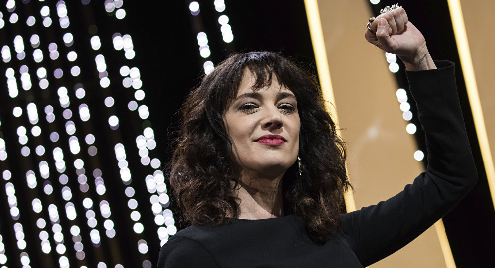 Actress Asia Argento gestures on stage during the closing ceremony of the 71st international film festival, Cannes, southern France, Saturday, May 19, 2018