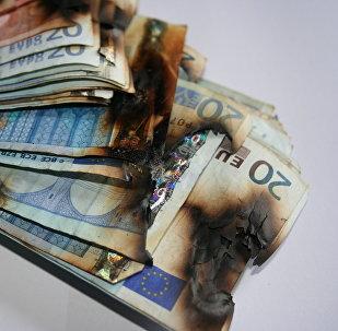 Billets d'euros brûlés