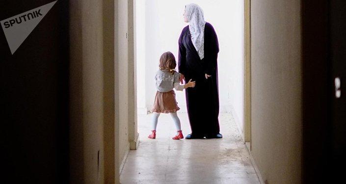 Une femme et une fille en Syrie, image d'illustration