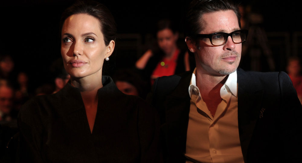 This file photo taken on June 13, 2014 shows US actress and special UN envoy Angelina Jolie (L) and her husband US actor Brad Pitt attending the fourth day of the Global Summit to End Sexual Violence in Conflict in London.