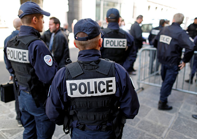 French police gather outside a local police station in Paris, France, October 11, 2016