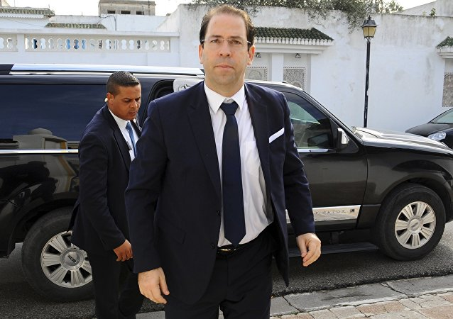 Tunisian Prime minister Youssef Chahed arrives at his residence in Carthage outside Tunis, Tunisia, before a meeting with prime ministers from the Benelux, Tuesday, Dec. 6, 2016.