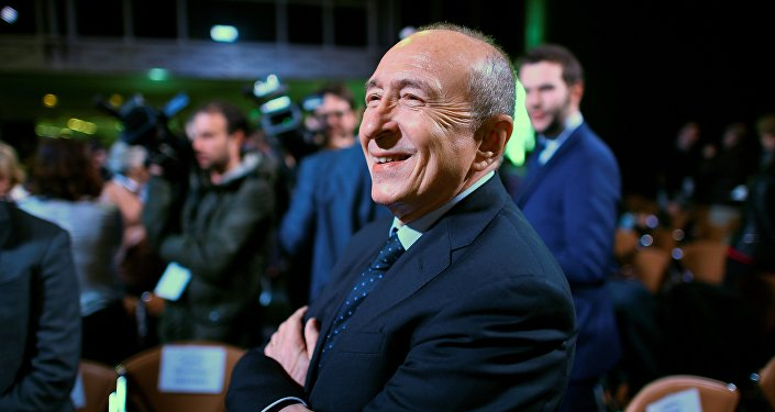 Mayor of Lyon Gerard Collomb waits for French presidential election candidate for the En Marche ! movement Emmanuel Macron prior to the unveil of his full programme eight weeks from election day, on March 2, 2017 in Paris.